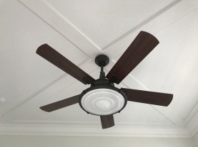 Criss cross pattern on this ceiling with this ceiling fan/light fixture.