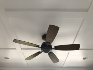 We added trim detail on the ceiling with this beautiful ceiling fan!