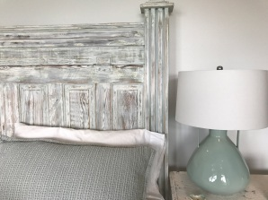 This headboard was made from an old door with jar lamp.